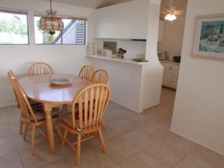 Encinitas townhome photo - Dining room to kitchen with maple dining set and new porcelain tile floors