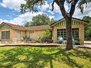 The hillside bungalows offer views of Lake Travis with plenty of shade.