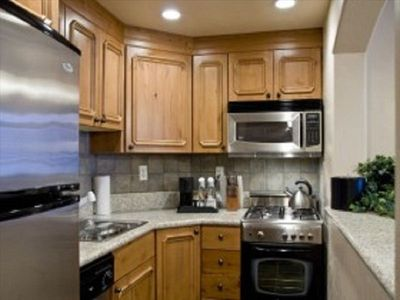 Kitchen equipped with fridge, dishwasher, microwave, oven, stove & accessories!