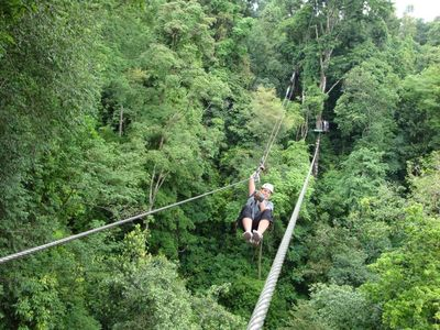 Zip Lining Through Rain Forest