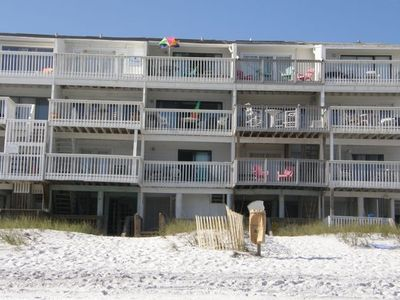 view from sugar white beach and water, showing 3 decks over beach dunes