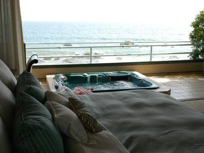 Master bedroom with spa overlooking beach/ocean