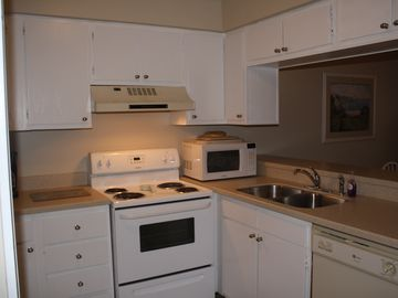 Stocked Kitchen, Solid Surface Counters, New Sink and Faucet