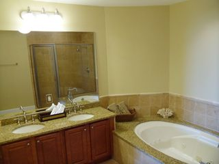 Master Bath with Whirlpool Tub and Shower - Santa Rosa Beach condo vacation rental photo