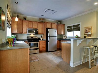 Fully furnished kitchen with stainless applicances and great views.