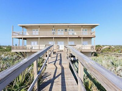 Oh yes, we are this close to the beach! - With extensive wrap-around porches and balconies, direct beach access, and room for 14, we can't think of a reason you wouldn't want to bring the family to Flagler Beach!