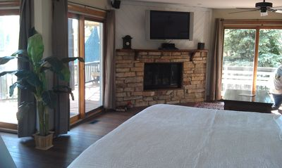 Saugatuck / Douglas house rental - master fireplace and view out to large private deck and water