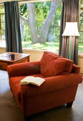 Wimberley property rental photo - Comfy chair perfect for reading a great book