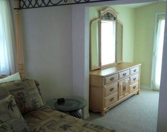 Master Bedroom, Queen Bed, with a door that goes out to balcony
