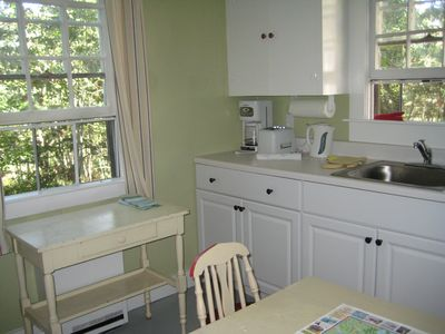 Guest Cottage fully equipped kitchen, has water view - great getaway.