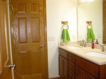 A Jack & Jill bathroom with double sink serves the master bedroom & bunk room.