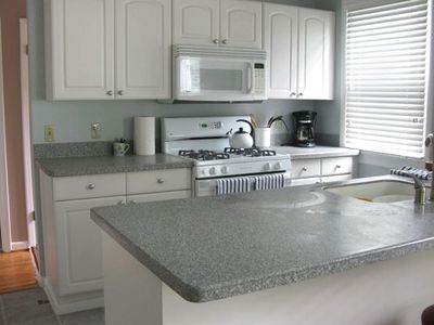 Remodeled Kitchen with Corian Counters and ceramic tile floor