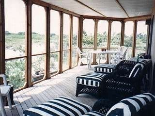 Screen porch with wildlife sanctuary view