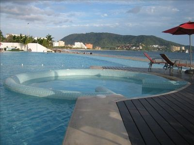 Relax and enjoy the view pool side or in the  whirlpool