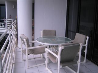 South Padre Island condo photo - Table and chairs to enjoy meals and watch the beach.