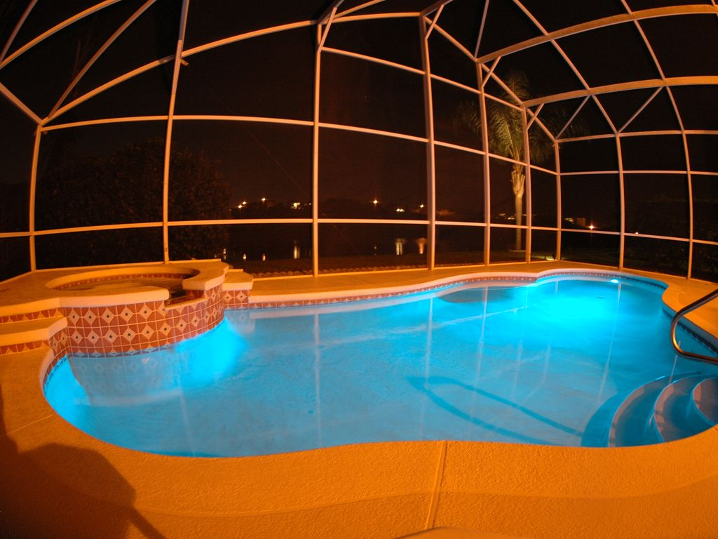 Colour changing light in pool at night