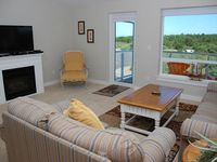 Luxury beach condo - Awesome view of lighthouse!  Walk to beach!
