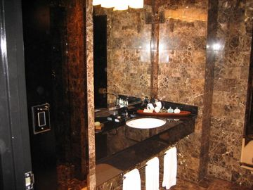 Luxury Marble Bathroom with Plasma TV and Rain forest Shower
