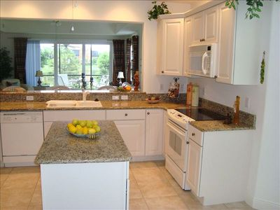 Spacious kitchen with bar, center island and lake view