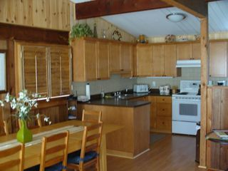 Orilla cottage photo - Completely renovated gourmet kitchen and dining area in main cottage
