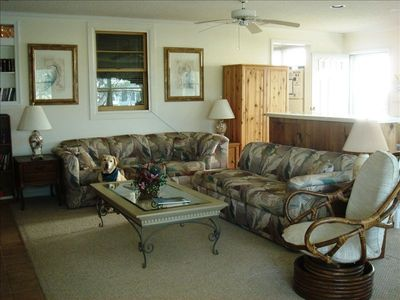 family room with a queen size sofa bed and breakfast bar seating for 4-5