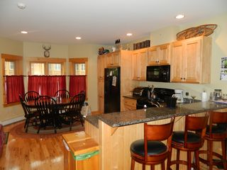 Carrabassett Valley condo photo - Dining and kitchen area. Beautiful granite counter tops.
