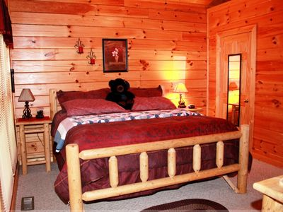King sized log bed with TEPUR-PEDIC mattress.