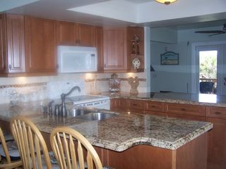 Fort Myers Beach house photo - Upgraded, fully stocked kitchen w/granite tops.