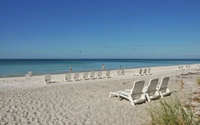 White sand beach with loungers for your use! Umbrellas also available