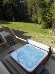 Warren chalet photo - Huge outdoor hot tub with views of the valley