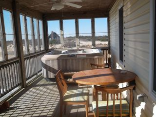 Carova house photo - Screened porch with hot tub and card table