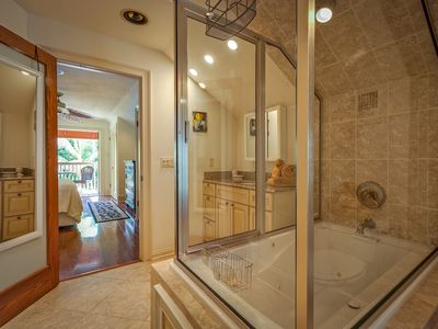 Master bathroom: glass-enclosed custom shower.