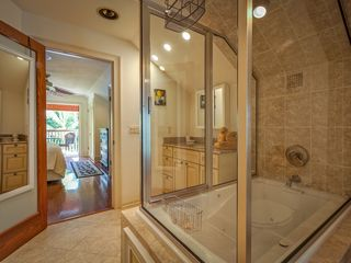 Key West house photo - Master bathroom: glass-enclosed custom shower.