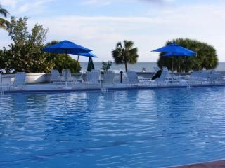 Key West condo photo - Our large pool with private beach access and an ocean view.... how beautiful!