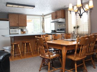 Crystal Mountain, Thompsonville lodge photo - Kitchen B, seating for eight around table and three more at kitchen island.