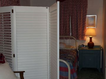 Shuttered screen offers privacy in the double second bedroom.