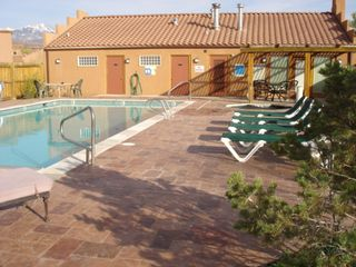 Moab townhome photo - Rim Village Clubhouse, Pool and Spa. Views of the La Sals in the distance.