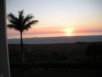 Sunset from your beachfront oasis