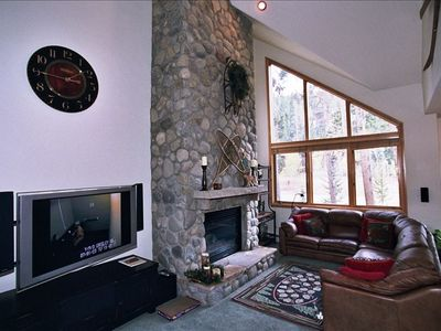 Stone fireplace; big screen TV