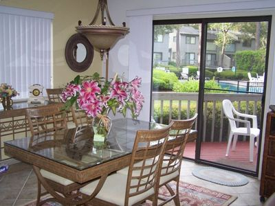 Beautiful Open Dining Area That Overlooks the Deck and Pool