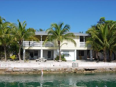 View of this large tropical getaway from the canal. Wedding packages available.
