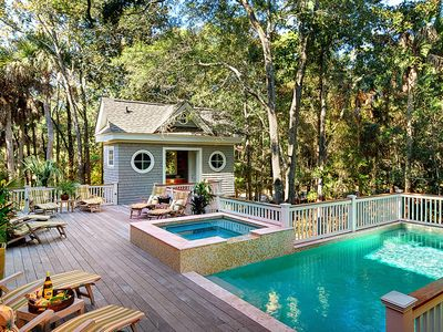 Deck with pool, spa, and outdoor bath house