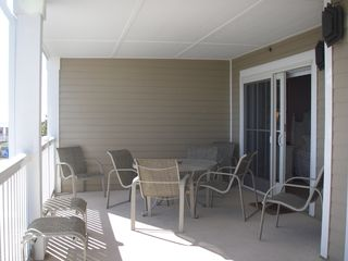 Isle of Palms condo photo - Spacious Balcony For The Whole Family seats 8