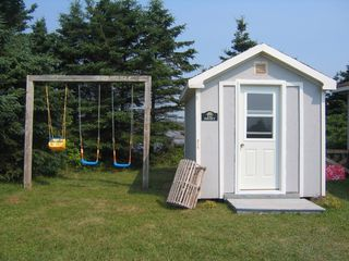 Augustine Cove cottage photo - Children love the playhouse and the swings!