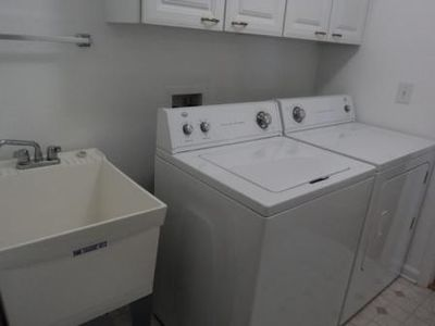 Full-size washer and dryer in the laundry room