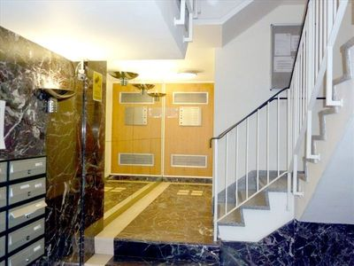 Entrance hall to building (lift behind stairs)