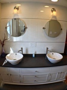 Lake Bomoseen estate rental - His & Hers vessel sinks in the Master Suite mounted on local VT plum slate