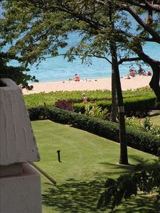 The Beach is right outside ~ the ocean view is from the lanai thru the trees.