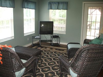 Living room overlooking Dock, Has satellite TV & DVD player.