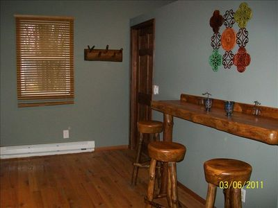 Breakfast bar/entry area with custom log seating